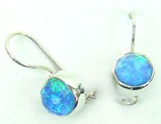 Sterling Silver Earrings with Opal Quartz Blue stone (AJER03) Specifications:  Silver wt. in gm : 2.05 Stone wt. in gm : 0.932 Gross Wt. in gm: 2.982