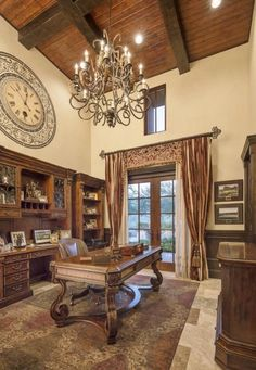 Elegant Home Office with Recessed Lighting assisting the Beautiful Chandelier.
