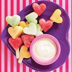 Valentines Snack! Heart fruit kabobs with yogurt. You can find the small heart stencils at the store and cut out from their favorite fruits!