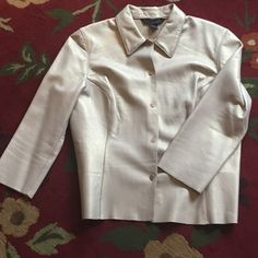 CHAMPAGNE GOLD GENUINE LEATHER SHIRT Fitted genuine leather shirt with three quarter sleeve length. Color is white gold or champagne. Fitted. Looks great open with Cami and jeans or even worn closed! Great condition. Tops