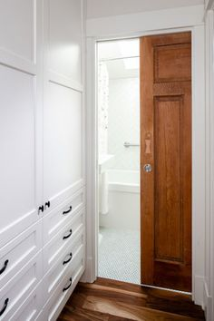 Sliding door in a bathroom renovation by Madeleine Design Group in Vancouver, BC. *Re-pin to your own inspiration board*