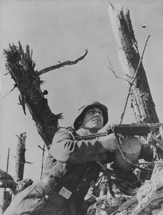 German soldier with MP-38 in the trenches on the Eastern Front