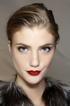 A little black liner + a red lip, classic Noir look.