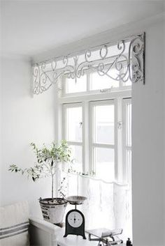 Oh my.... I love this idea... Love the metal window valance - some place in our house on Savage street
