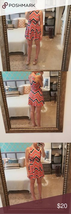 """Fit and Flair Dress I am selling a short and sassy """"skater"""" dress.  A fit and flare design with pink and navy blue chevron print and an empire waistline this is an excellent and feminine closet staple. Great condition, no rips or stains. Xhilaration Dresses Mini"""