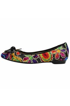 2d2b22bc9 A softened square toe puts a modern twist on this whimsical flat. With  vibrant colors. Shoptiques
