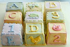 Baby Blocks Cake: This cake is actually made up of separate smaller cakes, designed to look like baby blocks. Babies will love to play with these faux toys-- and then eat them!