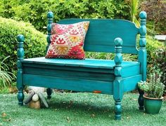 Old bed frame repurposed to a bench