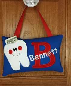Boys tooth fairy pillow, blue and red, door hanger, bed post hanger. by FabuMimi on Etsy https://www.etsy.com/listing/203359203/boys-tooth-fairy-pillow-blue-and-red