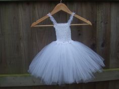 Gorgeous double layer Tutu Dress with frilled elasticated straps and diamante detail. From Age 2.