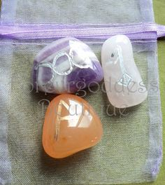 Goddess,Joy,Love+bind+Rune. Item # GJLR 01 Each is etched with the bind rune of Banned Amethyst : triple crescent moon – Goddess, Carnelian: Joy , Rose Quartz: Love They represent : Amethyst: All healing (mind, body, spirit), Inner peace, enchances conscious & understanding experience, deep meditation spiritual insight. . Rose quartz: Unconditional love, infinite peace, positive, energy, beauty, harmony, friendship. Emotional healing . : Carnelian : Career success, Grounding, motivation…