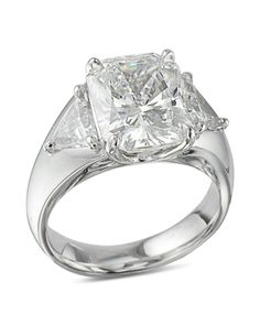 Platinum ring with 2 trillion cut diamonds with 5 carat radiant cut center.Price is for mounting only. Price will vary depending on the size of the center diamond as well as the size and quality of the trillions. Diamond Rings, Diamond Engagement Rings, Diamond Cuts, Radiant Cut, Gia Certified Diamonds, Platinum Ring, Jewelry Stores, Wedding Bands, Jewels