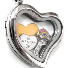 "This customizable memorial locket is made of high quality stainless steel with a magnetic closure that keeps the charms inside safe. The charms included are a small silver heart inscribed with ""in mem"