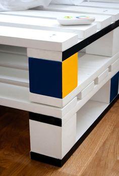 cubist, mondrian-esque painted shipping pallet bed