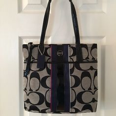 Coach F24666 Navy Pink Black Signature Tote Bag Silver hardware.  Zip closure.  Hang tag.  Front snap pocket.  3 interior pockets (1 zips).  Patent trim.  Never used.  Measures: 10.25x3x10.5x7.5. Coach Bags Totes