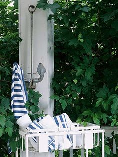 One-of-a-Kind Rack - Use an old boat anchor as a handy towel holder. Hang it up in a bathroom, poolside, or near an outdoor shower. The anchor could also be used as a clever coat rack near an entry.
