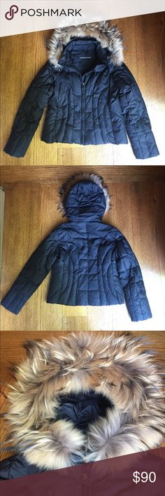 ANDREW MARC faux fur trimmed down jacket size L Adorable ANDREW MARC down jacket - trimmed with faux fur - 2 zipped outer pockets - 1 zipped inner pocket - size large - gently worn - bottom snap on hood is missing but the hood works perfectly anyway! Andrew Marc Jackets & Coats
