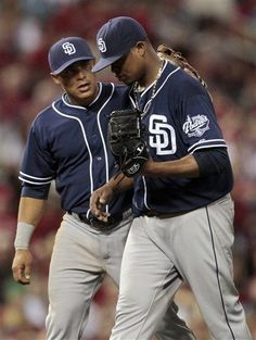 Game #44 5/22/12: San Diego Padres shortstop Everth Cabrera, left, talks with starting pitcher Edinson Volquez as Volquez pitches to St. Louis Cardinals' Tyler Greene with the bases loaded during the sixth inning of a baseball game Tuesday, May 22, 2012, in St. Louis. (AP Photo/Jeff Roberson)