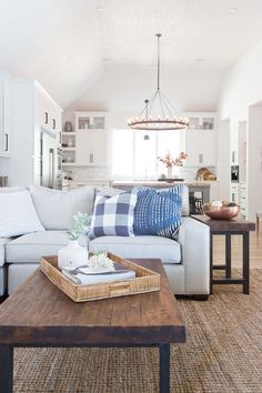 CC and Mike Tulsa Remodel Reveal, Pottery barn coffee table, Studio McGee pillows, kitchen remodel, best kitchens, beautiful kitchens, open floorplans, open kitchens, butcher block countertop, living room styling, living room decor, living room sectional, marble backsplash, kitchen window