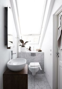 Small attic bathroom with large window