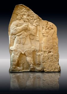 Moulding of 8th Cent. BC late Hittite rock relief . Warpalas, King of Tyana land, praying in front of a plant & storm god Tarhunza. From Ivriz (Konya, Ergeli) Turkey. Istanbul Archaeological Museum