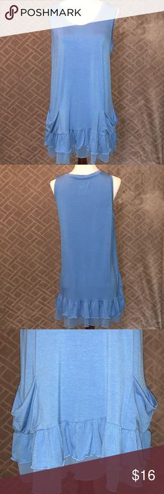 LOGO by Lori Goldstein Blue Tank Tunic LOGO by Lori Goldstein Baby Blue Tank   Tunic length Ruffled detail and pockets!   Sz medium  If you are not familiar with this brand it is very well made and super flattering. Tops skim over the body and provide a little bit of coverage in the back to wear with leggings or skinny jeans. Check out the other LOGO items in my closet. Bundle and save! LOGO by Lori Goldstein Tops Tunics