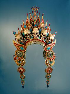 This is the crown of Mahākāla, a syncretic deity who is so different throughout Asia, he could almost be different gods. In India, he is a form of Siva. In Japan, Mahākāla is an exalted household deity associated with the kitchen and with wealth and luck. Creation Couture, Tiaras And Crowns, Royal Crowns, Mode Vintage, The Crown, Headgear, Headdress, Costume Design, Jewelry Findings