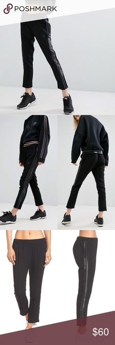 """Adidas Originals Cigarette Pants •Blending American and Tokyo street style, these cropped pants are sporty in a straight silhouette with allover pinstripes.  •Size Medium, true to size.  24 1/2"""" inseam, 12"""" leg opening, 10"""" front rise, 14"""" back rise.  •New with tag.  •No trades, no holds. adidas Pants Track Pants & Joggers"""