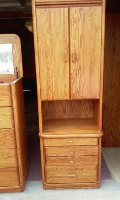This matching oak  set has a pull out glass section that can be used for books, glasses etc if used on either side of the bed.  There are 2 matching.  60.00 each or 210. for the entire set.