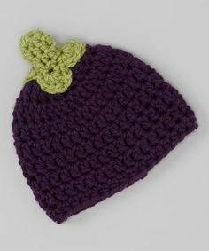 Classic crochet softness in rich earthy colors makes this handmade beanie hat a sure-fire hit. A cozy knit keeps the chill off little heads, while soft cotton stays comfortable with platefuls of panache.