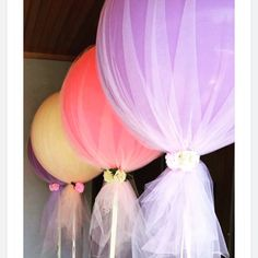 Tulle over balloons! I love this idea for a party! #partydecor #partyideas #weddingdecor #babyshowerideas #balloons