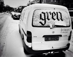 snow calligraphy on car. ephemeral art