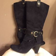 Black boots Suede-like upper, with faux leather strap + buckle detail. Full length zipper for easy on/off. In good, used condition, clean and well cared for. LOVE them, but can no longer wear them... Shoes