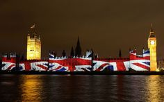 The Union flag is projected onto the House of Parliament during a light show to mark the start of the 2012 Olympic Games