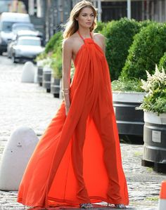 Red hot! Jessica Hart's slender figure was on display as she posed in a see-through red-orange maxi dress during a photo shoot in New York o...
