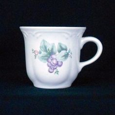This Pfaltzgraff flat coffee or tea cup features the Grapevine pattern.