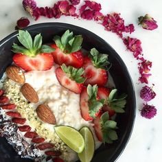 Porridge hot off the stove topped with strawberries, almonds, hemp hearts, cocoa nibs, goji berries, shredded coconut, and key lime. #healthy