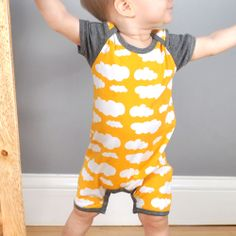 Romper one piece pattern made with white and yellow cloud jersey fabric!
