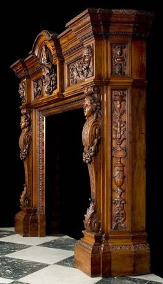 A Richly Carved Neo Renaissance Walnut Chimneypiece in the manner of, Salvatore Valenti, an Italian Sculptor active in Palermo, Sicily, 1835-1903.