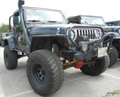 The owner of this Jeep TJ won a commissioned Jeep Painting from Custom Painting Studio at the BAJA Charity Jeep Show