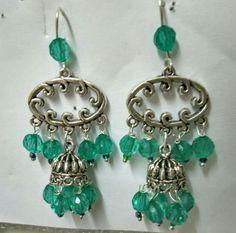 Ethnic chandelier earrings with sea blue acrylic drops