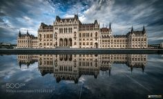 Parliament in the sea of clouds - Pinned by Mak Khalaf The hungarian Parliaments reflection Follow me on Facebook  And on Instagram City and Architecture skylandscapecitywaterreflectionbluecloudsarchitecturecityscapeartcanonpanoramabudapesthungarymirrorparliamentpopular by KrennImre
