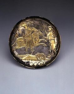 Sassanian silver gilt plate depicting a royal lion hunt, 500 AD.