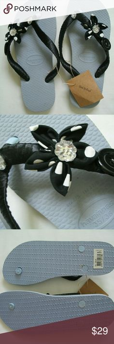 "Havaianas Beach Sandals Flip Flops NWOT Price is firm   Known for one of the most comfortable flip flops in the world these feature black Satin wrapped straps with black polka dot fabric flower embellished with big rhinestones and a black button. Lightweight, made in Brazil and hand decorated by a local Brazilian Artisan. Please see size chart under ""other"" for better understanding of sizes. Havaianas Shoes Sandals"