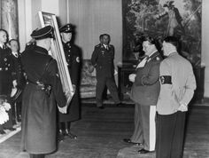 A photo from Jan. 13, 1938 showing Hermann Göring admiring a painting given to him by Adolf Hitler on the occasion of his 45th birthday. The treatment of the gigantic art collections of Hitler, Göring, Chancellery head and Hitler confidant Martin Bormann and other Nazi top brass counts as a particularly macabre chapter in Germany's efforts to come to terms with its Third Reich past.
