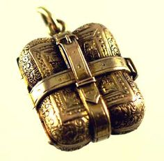 Gold locket with buckle