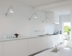 Bestlite lamps on the wall! White minimalist perfection.
