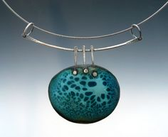 Patti Wells Designs  love this setting, need some cool designs for my enamels!