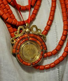 "#Ukrainian national women's jewelry: beads with corals and ""Dukach"" (traditional Ukrainian women's costume piece - decoration on the basis of a large coin in a decorative metal frame). Украинские народные украшения: коралы и подвеска-""дукач"". Ukrainian culture, Ukrainian traditions, Ukrainian style, Ukrainian roots, Ukrainian beauty / Украинская культура, украинские традиции, украинский стиль, украинские корни"