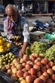Fruit vendor Jethabhai in a market in Jamnagar, Gujarat, India.